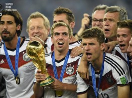 Germany's Lahm holds the World Cup trophy after the 2014 World Cup final between Germany and Argentina in Rio de Janeiro